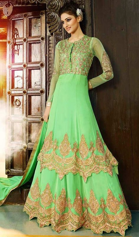 Make others envy you with this honeydew embroidered georgette lehenga choli suit. The butta, lace, patch, resham and stones work on attire personifies the total look. #LatestGoldenEmbroideredLongSkirtCholi