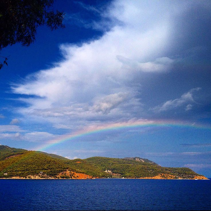 Rainbow. Greece. Poros. Colors. View. Clouds. Sky. Sea. Greek islands.