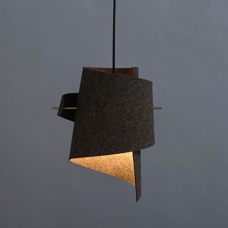 Wool felt lampshade in greybrown, brass rods, 4M black fabric wire. Cork lampshade, black stained beech wood rods, 4M black fabric wire. 30cm wide by 35cm h