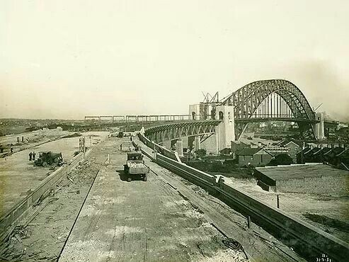 Construction of the road to the Northern Approach to the Sydney Harbour Bridge on the 30 July 1931. The picture is taken from about where Milsons Point Station is now. Source: State Archives of NSW