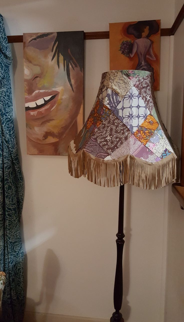 Dining room.  My art work and hand made lampshade.  More of my artwork at www.artyogaritual. com