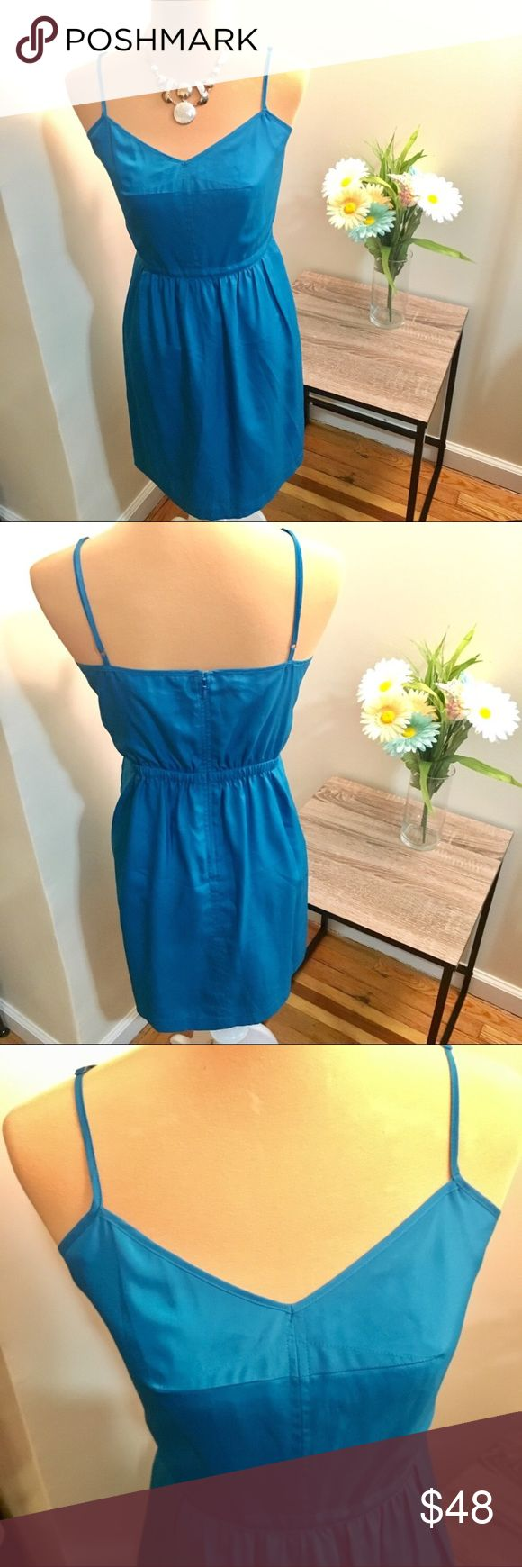 J. Crew Blue Cami Dress This J. Crew cami dress is previously owned and in excellent used condition.  Adjustable shoulder straps and zipper with clasp in back.  100% Polyester | Dry Clean Only J. Crew Dresses