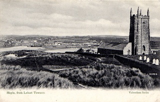 Valentines postcard showing a view of Hayle, from Lelant Downs. In the foreground stands St Uny Church and part of the graveyard. In the distance can be seen St Elwyn's Church. - Collections - Penlee House Gallery and Museum Penzance Cornwall UK