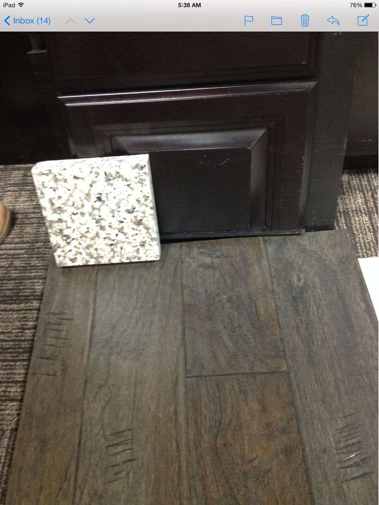 "Maple espresso cabinets, Armstrong 5"" engineered wood floor in misty gray, Crema Carmel granite for countertops."