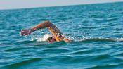 Breathing and Buoyancy in Open Water Swimming