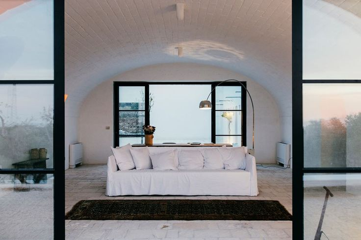#Masseria Moroseta: a white stone farmhouse standing proudly on the ridge with views across the olive trees to the sea #white #Italy #livingroom Project by Andrew Trotter Studio