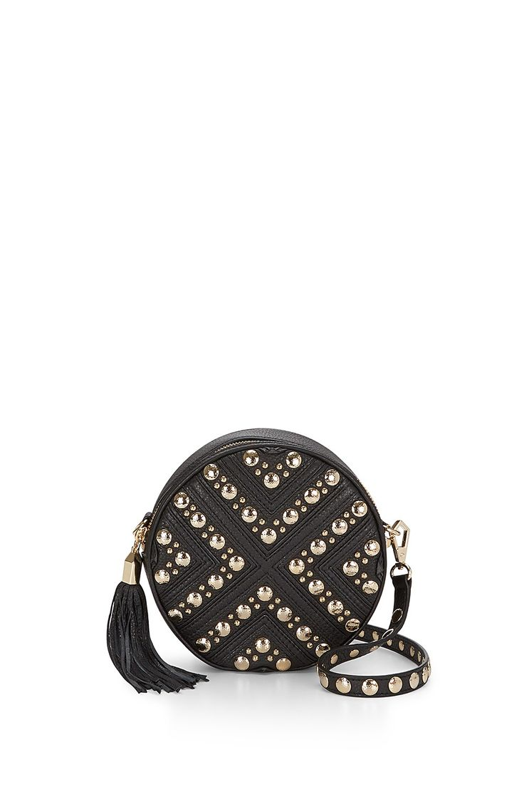 Bianca Crossbody - We love the circular silhouette of this chic crossbody. Adjust the strap to use it as a shoulder bag or remove it to carry it as a clutch.