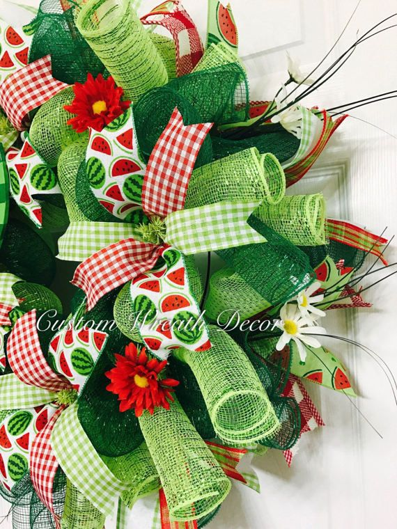 Give your guests a slice of the good life by displaying this beautiful Happy Summer Watermelon wreath on your door! Its sure to put a smile on everyones face! This wreath features two coordinating colors of deco mesh in metallic lime and emerald green. It is accented with four coordinating wired edge ribbons in a country red/white gingham check pattern, green/white gingham check pattern, apple green canvas chevron, and satin red and white polka dot. A 5 x 9 wooden watermelon sign th...