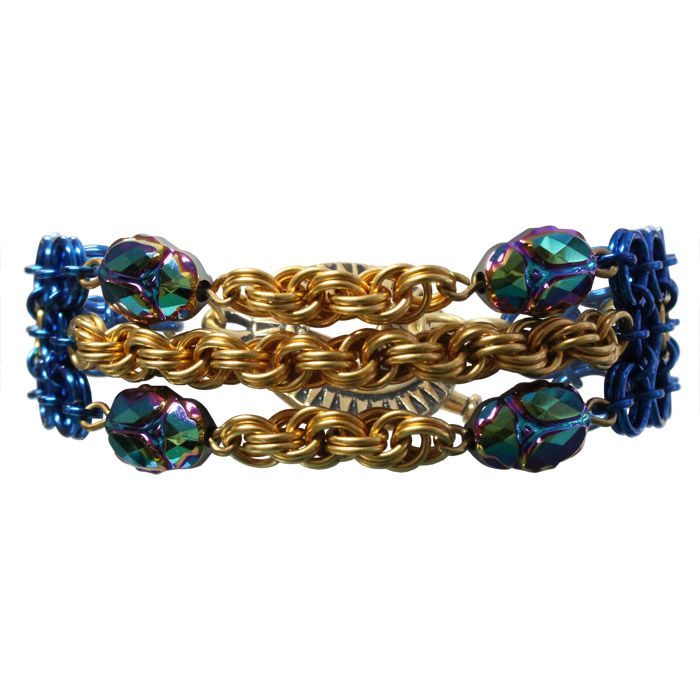 Queen of the Nile Bracelet has crystal scarab beads and golden double spiral chainmail taking center stage in this Egyptian-themed bracelet. In ancient Egypt, scarab beetles were associated with the Egyptian god, Khepri, who pushed the sun across the sky. The ancient Egyptian palette contained six main colors, each with specific meaning. Blue was symbolic of the heavens & water, representing creation & rebirth. Yellow was symbolic of the sun & of gold, representing the eternal…