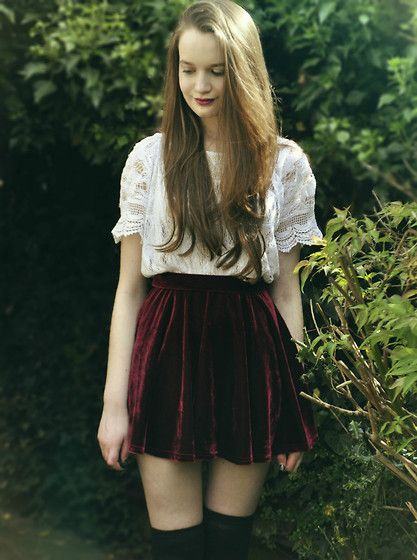 Red velvet skirt, white blouse, knee highs