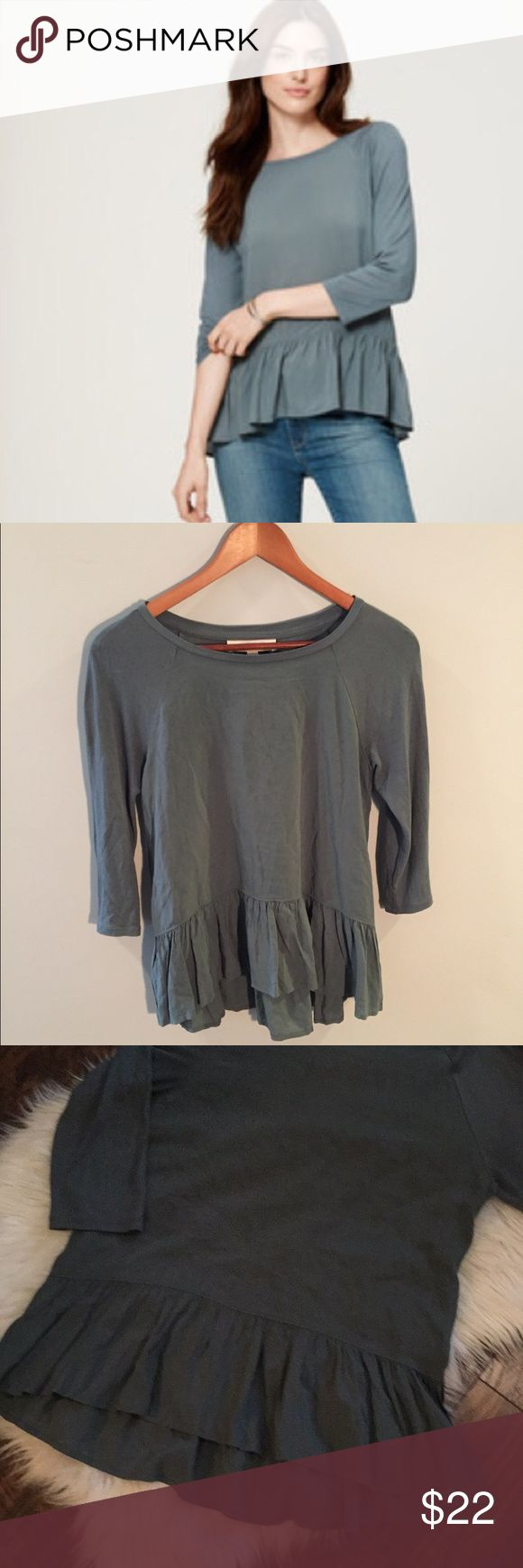 "•LOFT• Mixed Media Peplum Top in Green LOFT Mixed Media Peplum Top in Green. In Excellent Used Condition. Fluid woven panels meet a soft knit for the ultimate mix up- with a flirty Peplum Hem. Round Neck, 3/4 Sleeves.  When Laying Flat: Bust Measures Approximately 16.5"" Across, Length 24"" LOFT Tops"