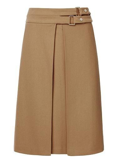 Wool/Viscose Wrap Buckle Skirt. Comfortable fitting silhouette features a wrap front, fixed waistband with twin Gold buckle belts at top body and side pockets with below the knee hem. Available in Camel as shown.