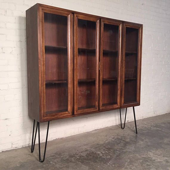 SHIPPING NOT INCLUDED: FOR LOCAL PICK-UP ONLY BUYER PAYS FOR & MAKES SHIPPING ARRANGEMENTS I SUGGEST PLYCONGROUP.COM OR USHIP FOR QUOTES MID-CENTURY MODERN DISPLAY CABINET W/2-GLASS DOORS & HAIRPIN LEGS -PRICE: $495 -MANUFACTURE: UNKNOWN -IN THE STYLE OF: MID-CENTURY MODERN
