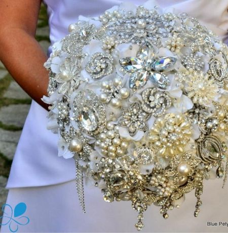This is a thing: Wedding bling. Blue Petyl bouquet.
