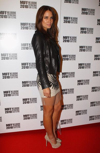 I love Jodi Gordon's edgy red carpet style - wearing a sequinned mini with sheer hem + fitted leather jacket.