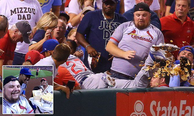 Andrew Gudermuth, from Sikeston, Missouri, was watching the game in St. Louis yesterday with his nephew and girlfriend while enjoying a plate of cheesy nachos.