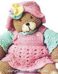 Click for this free crochet pattern - I've made it myself (just the bear, not the clothing) and it came out great. There are also patterns here for clothing for the bear.