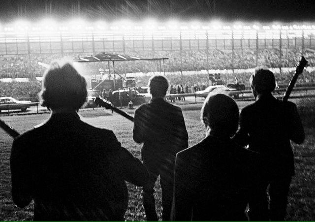 The Beatles walking out to their last live concert at Candlestick Park, 1966.  by Harry Benson