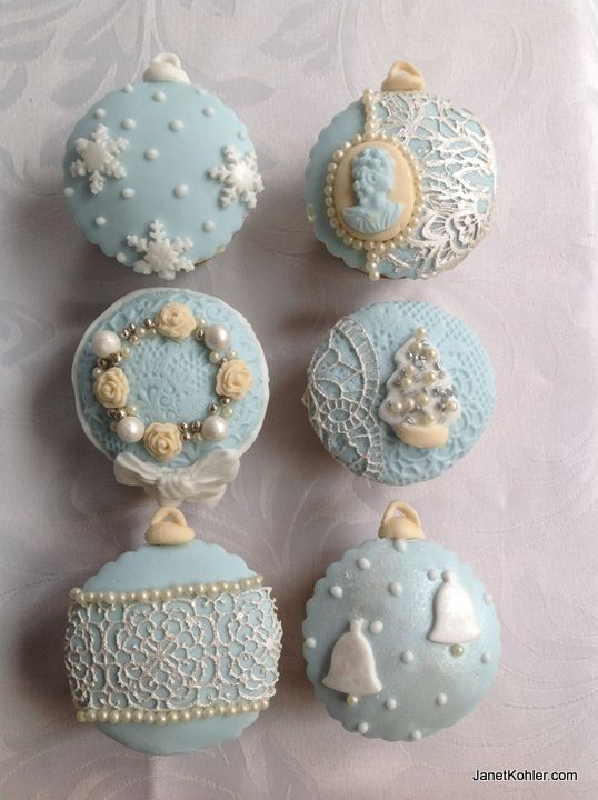 Blue and ivory themed icing for Christmas cupcakes