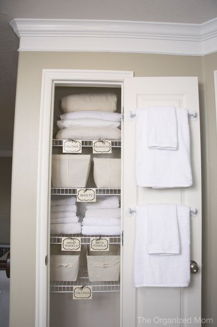 Stash a couple sets of ready-to-grab towels on the inside of your closet door to make it easy for guests or young kids to find the ones they can use for their next shower. See more at Organized Mom »