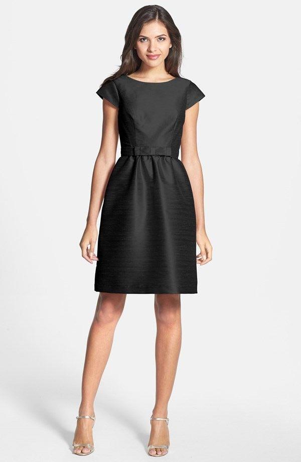 Loving this black bridesmaid dress with petite bow sash. | See more preppy bridesmaid dresses here: http://www.mywedding.com/articles/preppy-bridesmaid-dresses/
