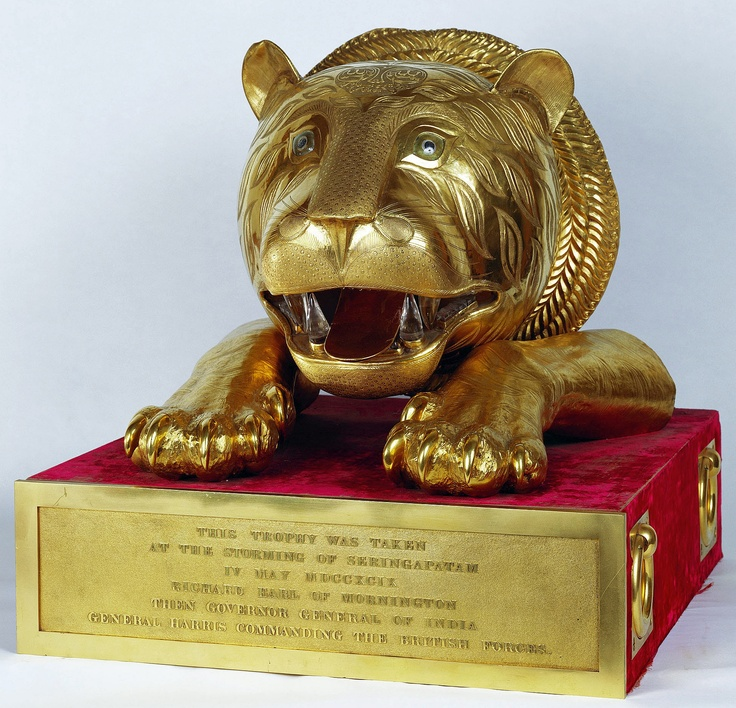 Tiger's head and fore paws (gold, rubies, diamonds, rock crystal), presented to William IV by the East India Company, 1831. Looted by British forces from the palace/fortress (Seringapatam) of Tipu Sultan, (The Tiger of Mysore).