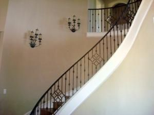 Wrought iron stair railing- possibly do similar design with quatrefoil?? by jocelyn