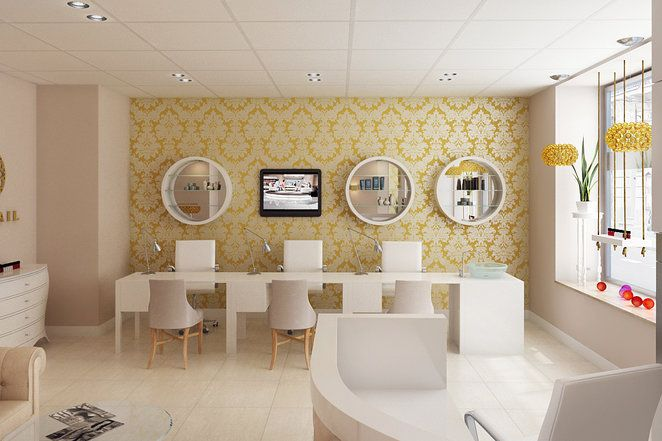 View of the manicure area; manicure tables in a row with cool wallpaper