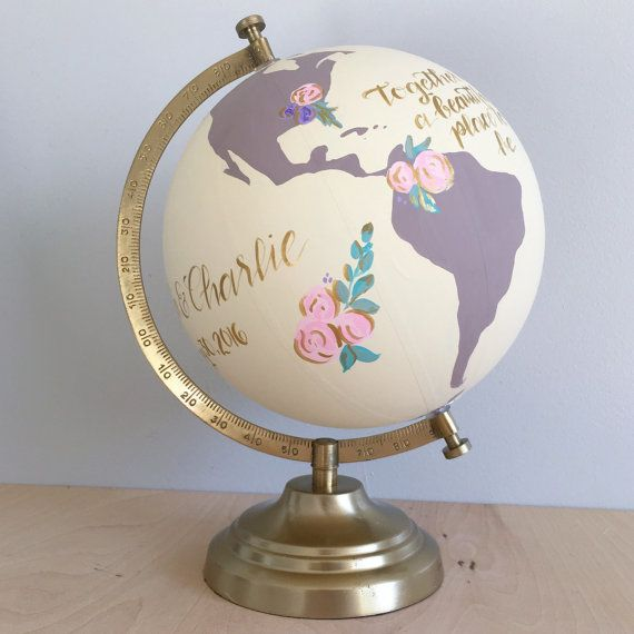 This listing is for a custom hand painted and hand lettered 8 diameter desktop globe with floral arrangement accents. Globes are ideal for weddings, anniversary, graduation, birthday, job promotion, new job congratulations, nursery, house warming, or going away party for friends and family to sign and/or home decor.  *Pictured with ivory oceans, mauve continents, floral arrangements outlined in gold, gold lettering and gold stand. **8 holds approximately 75 guest signatures**  Globes are…