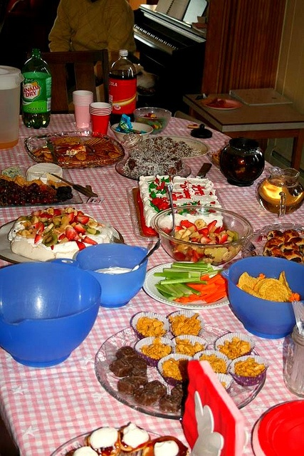 Aussie-style party: pavlova, lamingtons, sausage rolls, cream cheese with sweet chili sauce, fruit salad, twisties, violet crumble, mini-quiches, honey joys, jam-and-cream pikelets