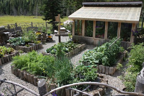 Raised beds and greenhouse/sunroom
