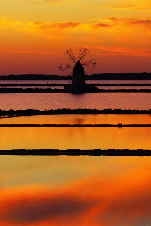 Salt flats at sunset in Trapani.