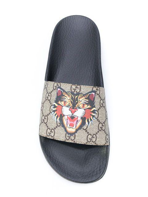 8c5c07f8155 Shop Gucci GG Supreme Wild Cat sliders.