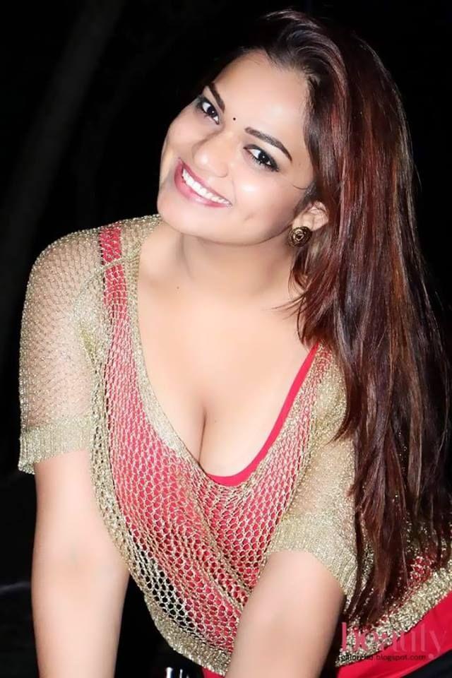 Bhojpuri Hotshot Monalisa Flaunts Massive Cleavage In A White