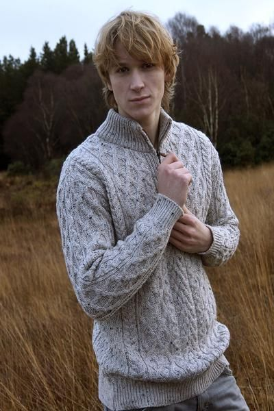 If you love picking up special items for your special guy, he will love receiving this Half Zip Aran Sweater. This amazing combination of knitwear was designed