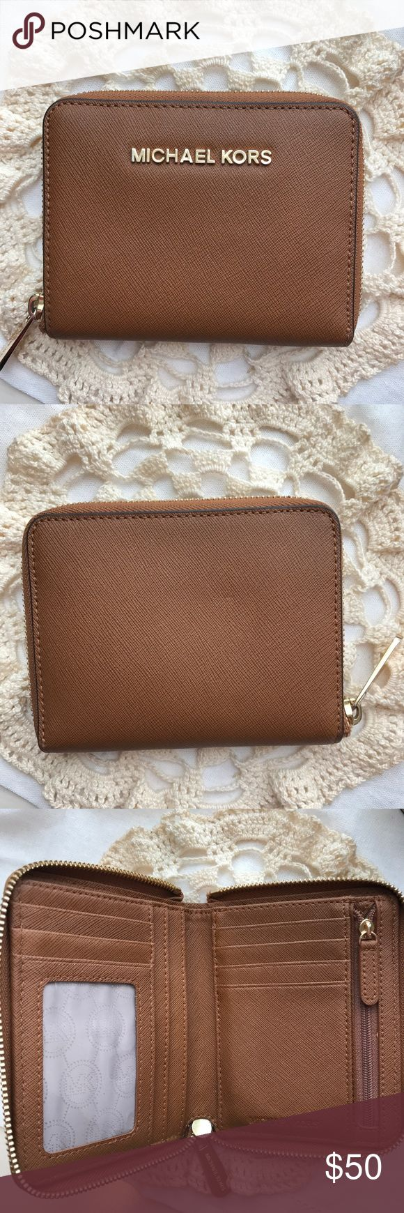 Michael Kors Wallet Michael Kors brown/tan small zip around wallet. In like new condition; only used for a month long trip to Europe. Reasonable offers are always accepted! Michael Kors Bags Wallets