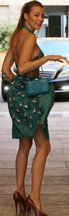 Blake Lively Gucci pumps, green print halter dress, and blue handbag