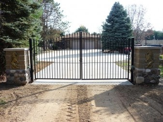 This Aluminum Driveway Gate in front of a new construction home adds elegance as well security to the property.  It is very strong and Maintenance free.  To learn more about Entrance Gates go to http://www.fence-depot.com/fence/driveway-gates/