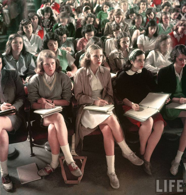 1949 of life on campus at Smith College, a women's private liberal arts college in Northhampton, MA -- judging by the class size, I'm guessing they're all learning about the history of rock and roll, electric guitar as a phallic symbol, etc etc