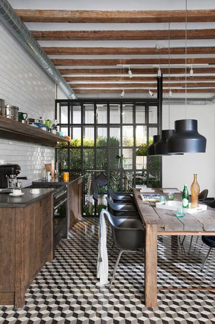 industrial kitchen by Egue y seta. Love the mix of wood, subway tile, lighting and windows
