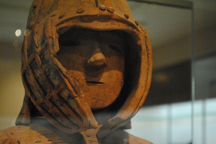 Warrior in Keiko Armor.   Haniwa (Terracotta Tomb Figurine)  From Lizuka-machi, Ota-shi, Gunma. Kofun period, 6th century.  Courtesy & currently located at the Tokyo National Museum, Japan. Photos taken by B.Kelly.