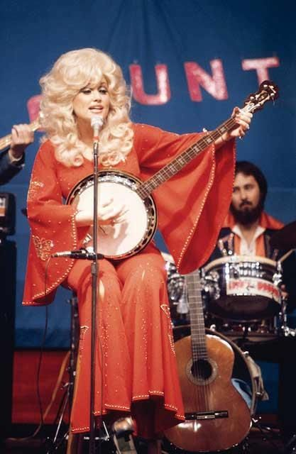 Dolly Parton - God I wish she had a sweeping fringe in this photo, in the shape of a C...