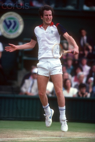 1982 - John McEnroe punching a backhand during a match on Centre Court at Wimbledon