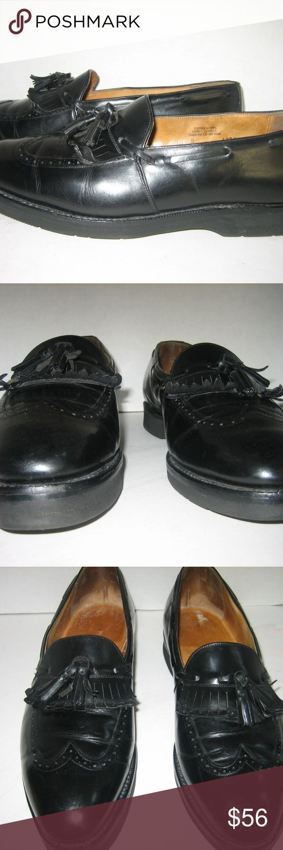 """Men's Black Leather Wing-tip Tassel Loafers, 10. D Black tassel and kiltie design with wing-tip. Easy slip-on with man-made """"Vibram"""" wedge heels. Leather uppers and leather linings. Neat interiors. No holes or tears. Maker brand name unknown.   Outer sole longest length 12.25"""". Widest width of outer sole 4"""".  Left shoe 1"""" heel. Right shoe heel 1.25"""".   Some minor upper leather and minor mid-sole scratches. Light outer sole walking wear. BRAND NAME ON   INSOLES, BUT NOT VISIBLE ENOUGH TO…"""