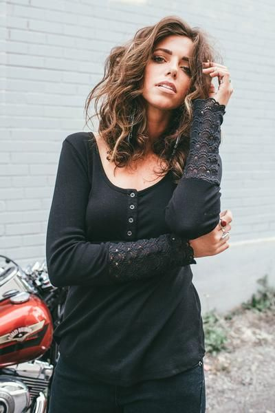 Get a little lacy in the Metal Mulisha Maiden's Rollin top. This long sleeve…