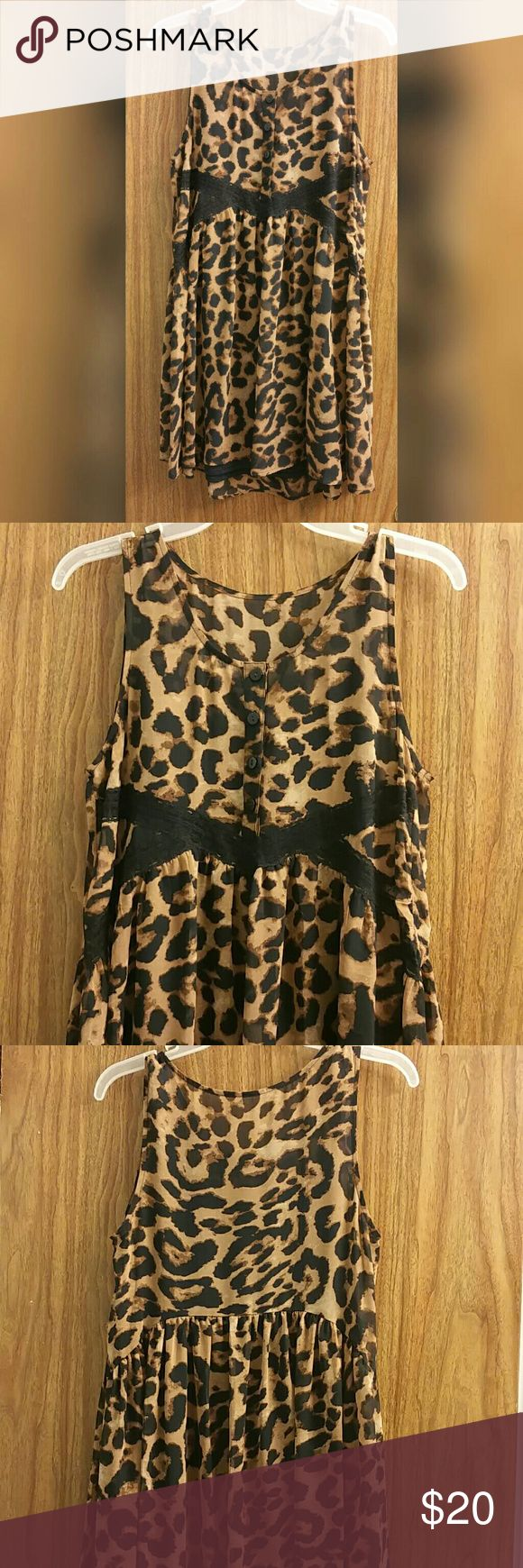 Express Leopard Print Dress Beautiful sheer polyester/rayon dress has black lace details along the sides, a gorgeous leopard skin print, and a book style fit to flatter any figure. Unavailable in stores, this beauty has been worn only once! Express Dresses