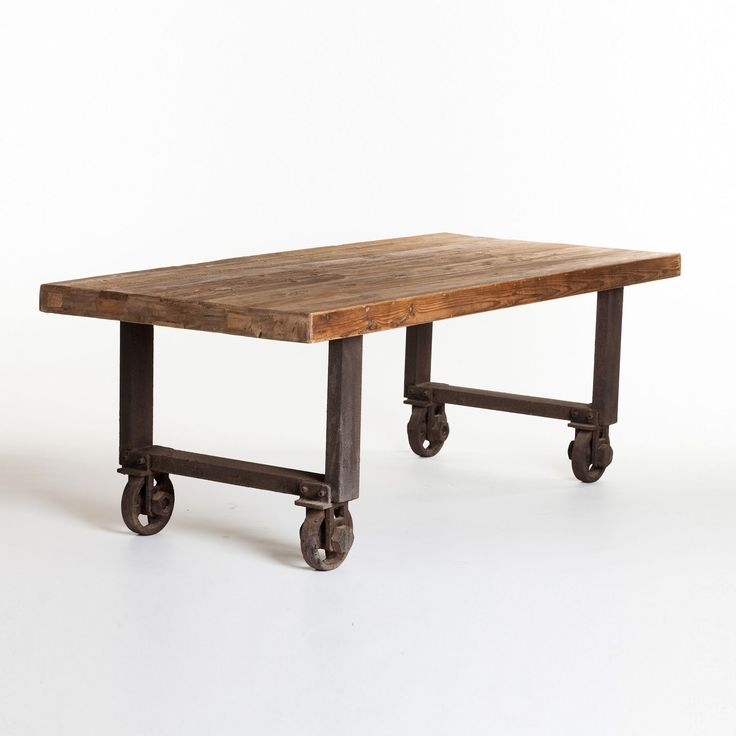 Love industrial style? It can be difficult to give a dining room that rugged edge, but we think this gorgeous table ought to do the trick. Heavy iron wheels make a hearty counterpoint to the thick, rustic-finished pine top.