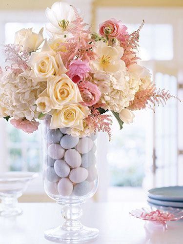 LOVE the arrangement - Artificial eggs surround a water-filled glass in the middle of the vase. Get the complete instructions. #Easter