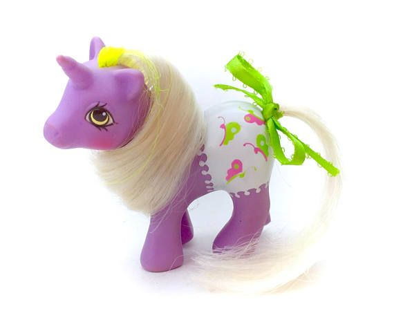 A beautiful G1 My Little Pony baby glider fancy pants diaper baby complete with a lovely matching tail ribbon! She is really lovely to display! minod signs of age and play only. I have HUNDREDS more cute vintage toys and collectables just like this for sale in my Etsy shop! Check out