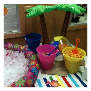 Gramma's retirement party - summer/beach theme - sand pails as serving dishes holding chips ...